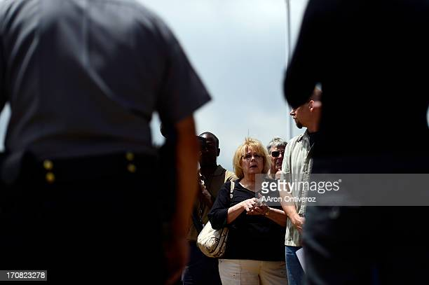 Residents listen as Sheriff Terry Maketa speaks during a press conference held by the El Paso County Sheriff to inform residents of their...