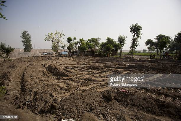 Residents living in a disappearing slum look over freshly graded land in front of their homes April 23 2009 where agricultural areas they and members...