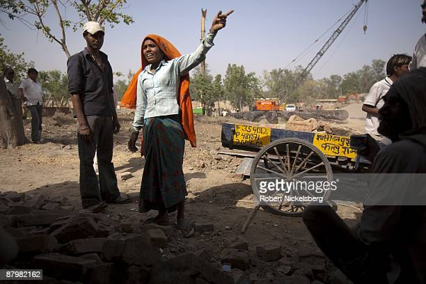 Residents living in a slum remove bricks to relocate their home April 23 2009 where agricultural areas they and members of twelve families have been...