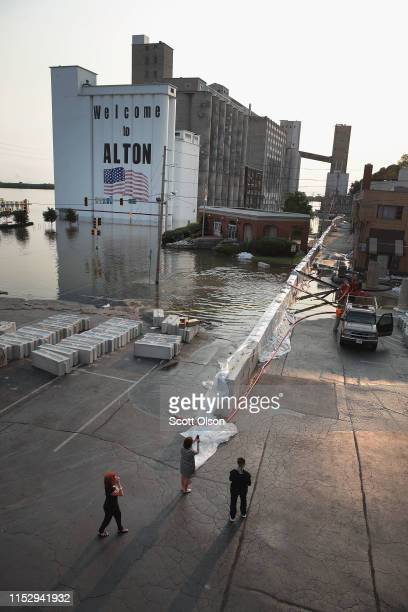 Residents look at flooding from the Mississippi River in the downtown area on May 31 2019 in Alton Illinois The middlesection of the country has been...