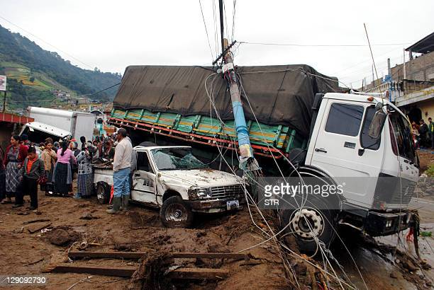 Residents look at the damages caused by heavy rains in Almolonga municipality Quetzaltenango departament 220 km west of Guatemala City on October 12...