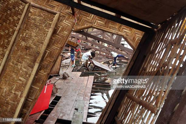 Residents look for their belongings among destoryed houses after a large earthquake that hit Cantilan Surigao City in southern island of Mindanao on...