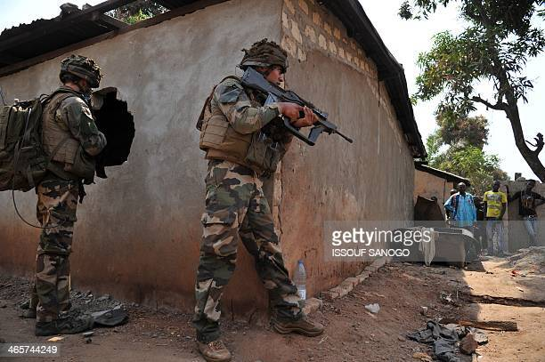 Residents look on as French soldiers of Operation Sangaris patrol in Bangui on January 29 2014 Gunfire erupted on January 29 in Bangui still plagued...