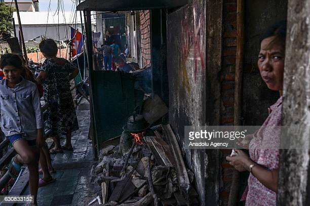 Residents look on outside one of the squatted apartments during a protest at the Borei Keila site in Phnom Penh Cambodia on January 3 2017 Families...
