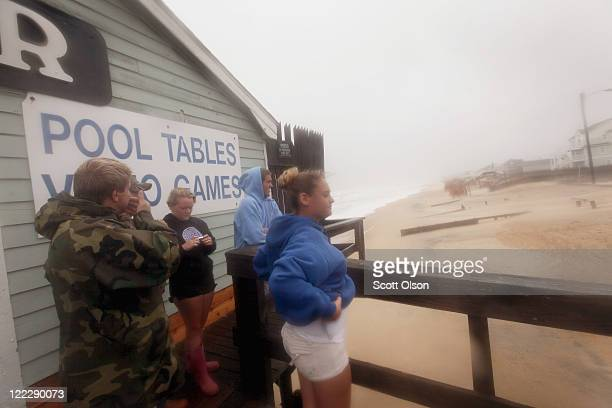 Residents look out over the beach during Hurricane Irene August 27, 2011 in Kill Devil Hills, North Carolina. Hurricane Irene hit Dare County, which...
