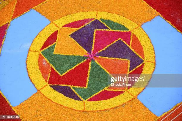Residents made colourful flower Rangoli on road for immersion celebration of Lord Ganesh, Sangli, Maharashtra, India