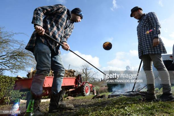 Residents make pancakes with a wood fire at Valennes, near Le Mans, north-western France, on February 17, 2021. - Since the 1905 French law on the...