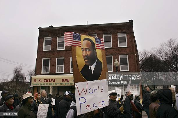 Residents march in a Martin Luther King Jr Day parade January 15 2007 in Bridgeport Connecticut King was assassinated in 1968 in Memphis and would...