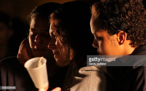 Residents mourn the death of Chelsea King during a candelight vigil on Tuesday March 2 2010 in Poway California King went missing on Thursday when...