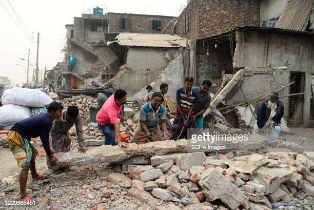 Residents move pillars of their demolished house. Bangladesh Inland Water Transport Authority conducts a drive to evict illegal structures from the...