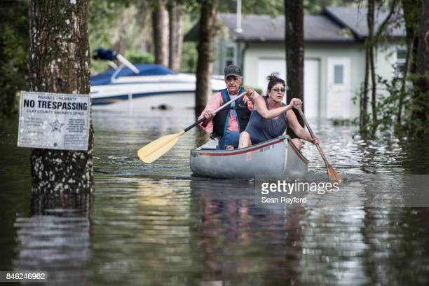 Residents navigate floodwaters caused by Hurricane Irma on September 12, 2017 in Middleburg, Florida, United States. The storm brought flooding to...