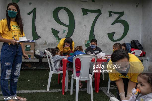 Residents observe first aid training promoted by firefighters for the Paraisopolis neighborhood on May 6 2020 in Sao Paulo Brazil The local community...