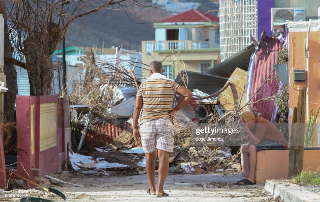 Residents observe the damage left by Hurricane Irma on September 11, 2017 in Philipsburg, St. Maarten. The Caribbean island sustained extensive damage from the powerful storm.