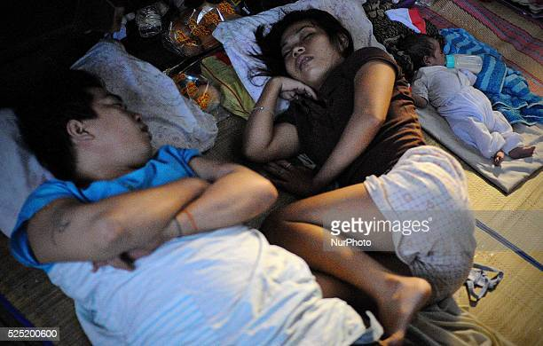 Residents occupy a church converted into an evacuation center in Quezon city Metro Manila Philippines August 21 2013 As tropical storm Trami exits...