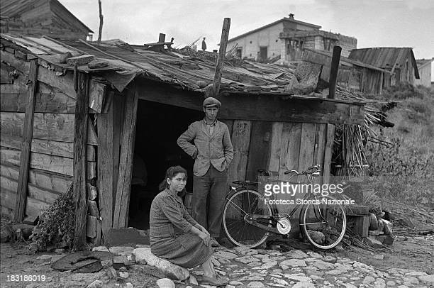Residents of a shantytown built by the workers of a new Montecatini facility on a lot set aside by the company for this purpose circa 1950 From the...
