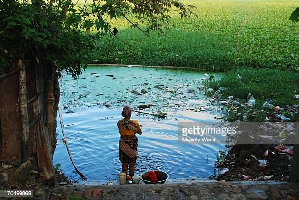 Residents of a slum have no choice but to use polluted water from the pond Askerdighi for their daily needs The groundwater is being polluted in...