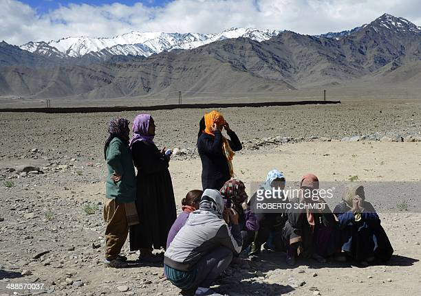 Residents of a small enclave in the Indus river valley line up outside a rural school to cast their ballots in Shushot Yongma near the northern...