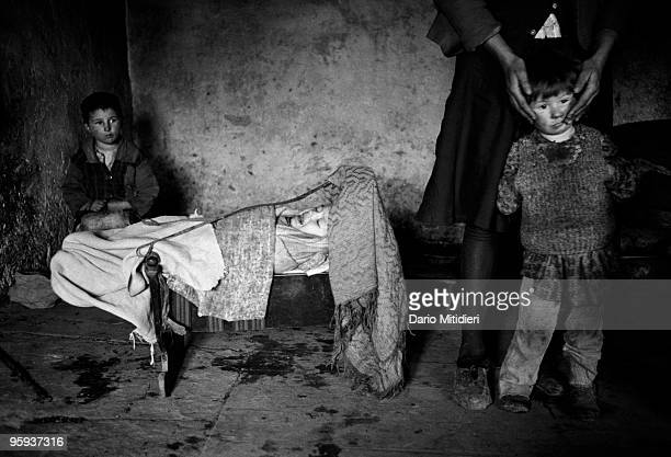 Residents of a small village in north Albania wait for help following the fall of the Communist regime in 1991 The Italian Army in what was called...