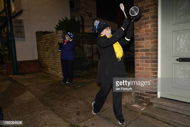 Residents of a street in Saltburn stand socially distanced outside their homes and take part in the Clap for Heroes event on January 07, 2021 in...