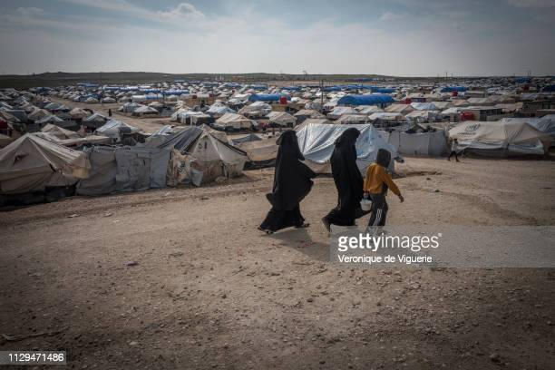Residents of alHawl refugee camp in northeast Syria where most civilians arrive after fleeing Baghouz the last village held by ISIS in Syria The camp...