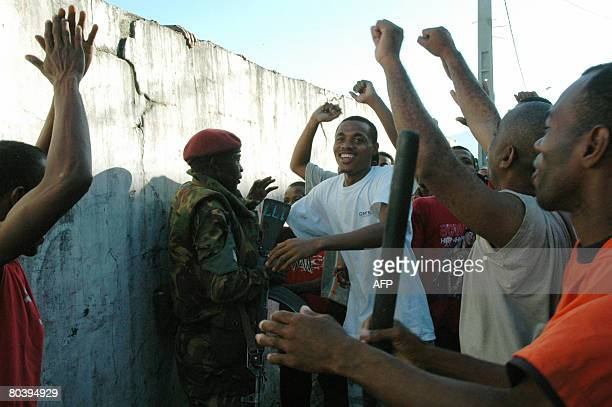 Residents of Anjouan celebrate next to a African Union soldier after their contingent came to shore on March 25 2008 Comoran forces and African Union...