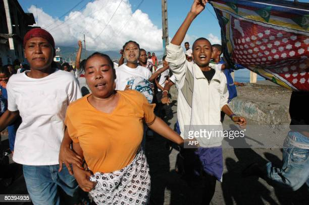 Residents of Anjouan celebrate the arrival of African Union troops after their contingent came to shore on March 25 2008 Comoran forces and African...