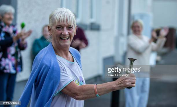 "Residents of Arrael Street Clap For Carers on May 14, 2020 in Abertillery, Wales, United Kingdom. Following the success of the ""Clap for Our Carers""..."