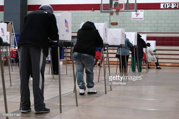 Residents of Baltimore City cast votes as early voting begins in the state of Maryland at Edmondson High School on October 26, 2020 in Baltimore,...
