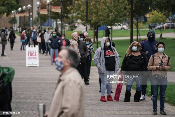 Residents of Baltimore City line up at Morgan State University to vote as early voting continues for a second day in the state of Maryland on October...