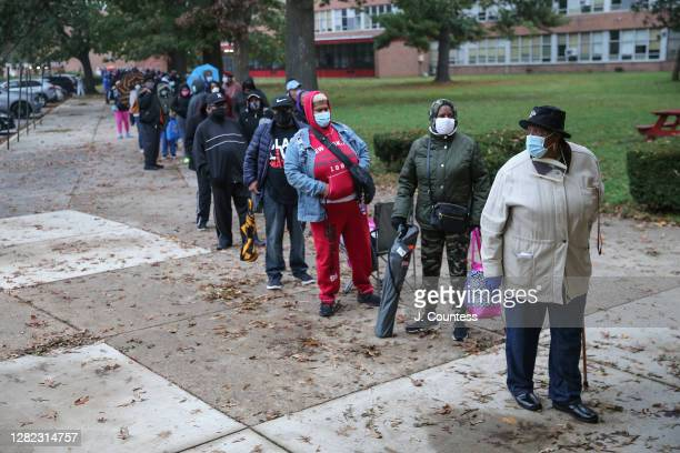 Residents of Baltimore City line up to vote as early voting begins in the state of Maryland at Edmondson High School on October 26, 2020 in...