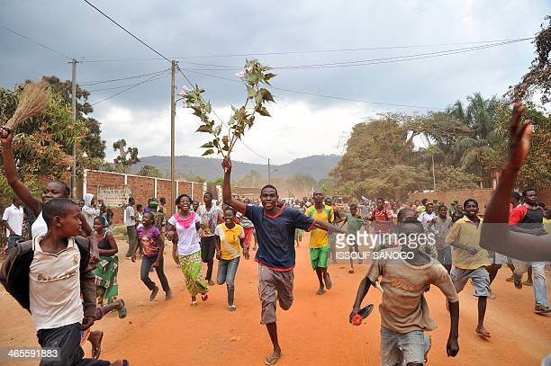 Residents of Bangui celebrate after former Seleka rebels were escorted out of Kasai military camp in Bangui to another camp outside the city on...