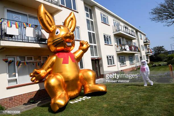 Residents of Belle View Mansions in Southbourne erect a huge blow up Easter bunny to show support for the NHS on April 10 2020 in Bournemouth United...