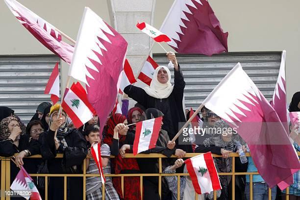 Residents of Bint Jbeil wave Lebanese and Qatari flags as Qatar's Emir Sheikh Hamad bin Khalifa alThani tours reconstruction efforts partially funded...