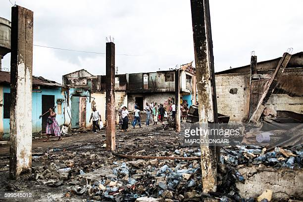 Residents of Bitam on the north of Gabon near the border with Cameroon walk through burned warehouses on September 5 2016 On September 1 post...