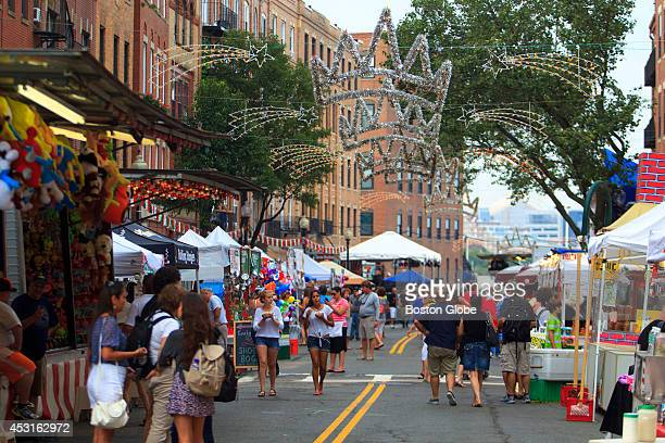Residents of Boston's North End as well as tourists from near and far gathered on Hanover Street for the Saint Agrippina festival on Friday August 1...