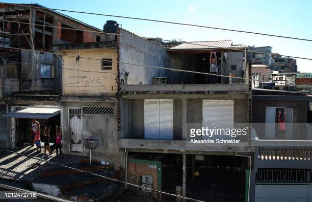 Residents of Brasilandia exercise as Ivan Pereira do Nascimento 39 years old conducts training sessions from the roof of his house amidst the...