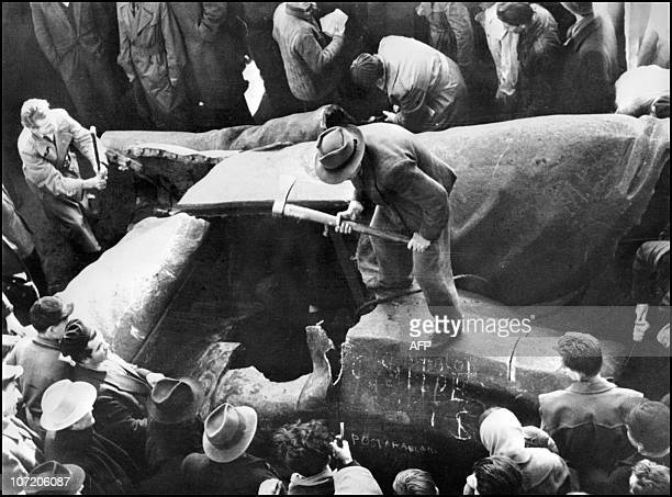 Residents of Budapest destroy 02 November 1956 a huge statue of Stalin downtown the Hungarian capital during a demonstration against the communist...