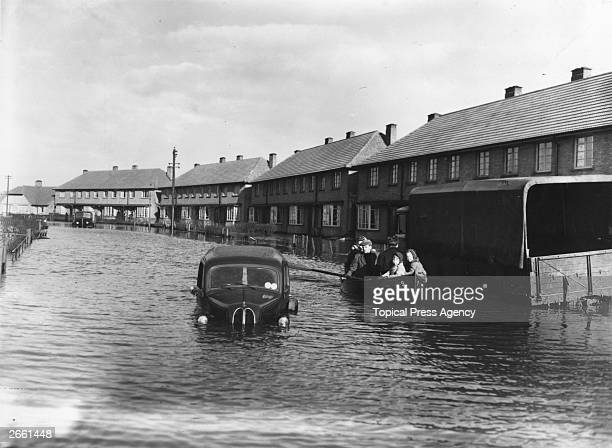 Residents of Canvey Island Essex being rescued by boat during the disastrous floods
