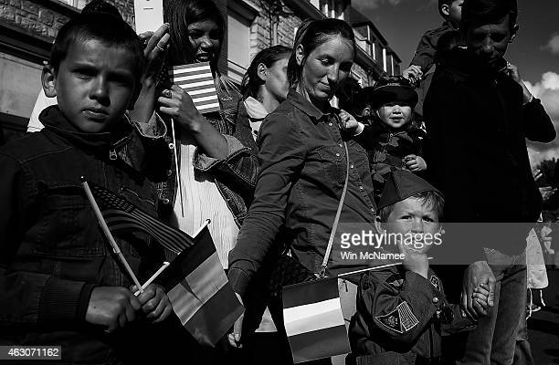 Residents of Carentan watch a military parade marking the week of DDay June 4 2014 in Carentan France The invasion saw 156000 troops from the allied...