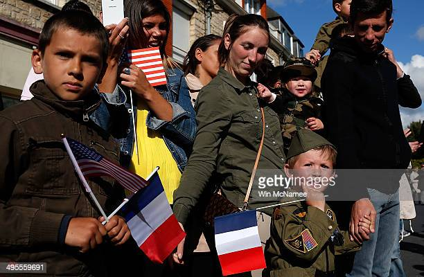 Residents of Carentan watch a military parade marking the week of DDay June 4 2014 in Carentan France June 6th is the 70th anniversary of the DDay...