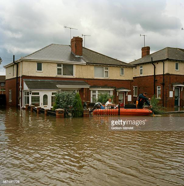 Residents of Catcliffe Village have to travel on a dingy through the flooded streets of their village This was one of the communities flooded when a...