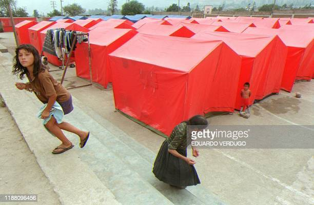 Residents of Chaclacayo 26kms east of Lima use tents set up by the Peruvian Civil Defense department as new homes 17 March after the Rimac River...