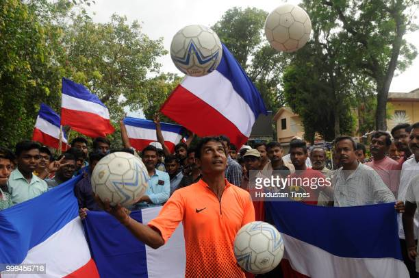 Residents of Chandannagar a former French colony till 1950 cheer for France before FIFA World Cup Final against Croatia at Strand beside river...