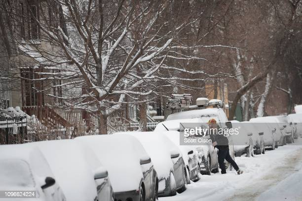 Residents of Chicago dig out after a snowstorm passed through the area on January 19 2019 in Chicago Illinois Snowfall in the city and surrounding...