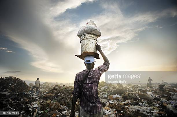 Residents of Cite Soleil live by the mass garbage dump and scavange to find food among the garbage October 31 2010 in Port au Prince Haiti Many of...