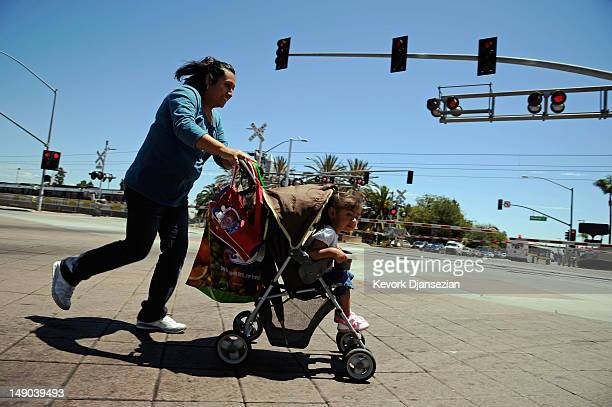 Residents of City of Compton cross the street on July 19 2012 in Compton California The City of Compton located south of Los Angeles with a...