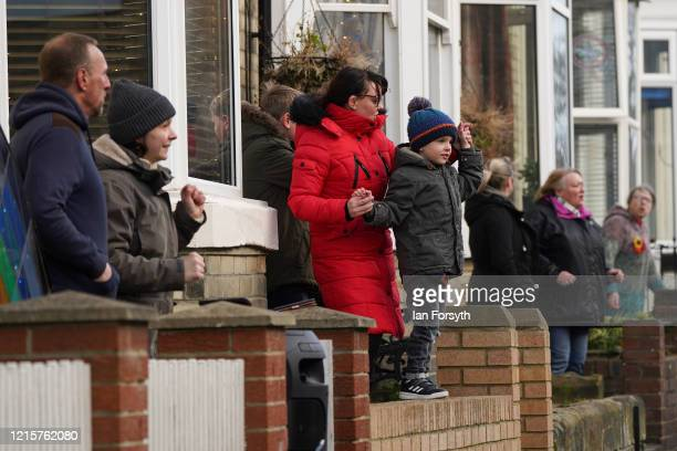 Residents of Coral Street in Saltburn come out of their homes at 6pm each evening to take part in Sing at Six as the UK adjusts to life under the...