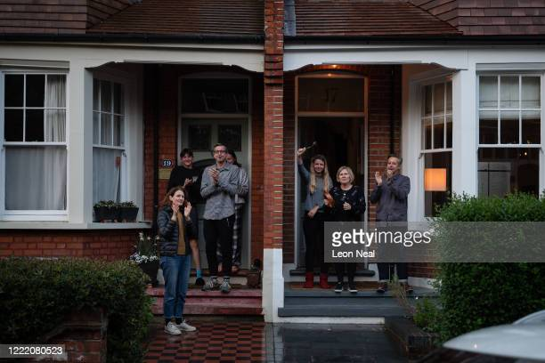 """Residents of Crouch End applaud from their doorsteps during the weekly """"Clap for Carers"""" on April 30, 2020 in London, United Kingdom. Following the..."""