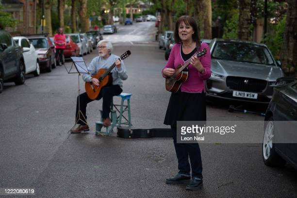 Residents of Crouch End sing along as a man and woman perform Get by with a little help from my friends by The Beatles following the weekly Clap for...