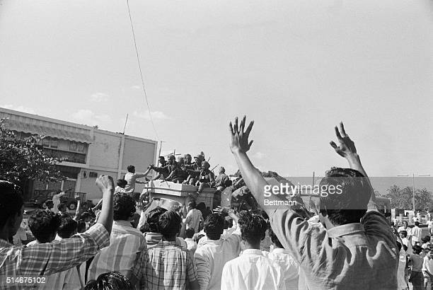 Residents of Dacca East Pakistan cheer as Indian troops enter the city after the surrender of Pakistani forces This ended the eastern war between...